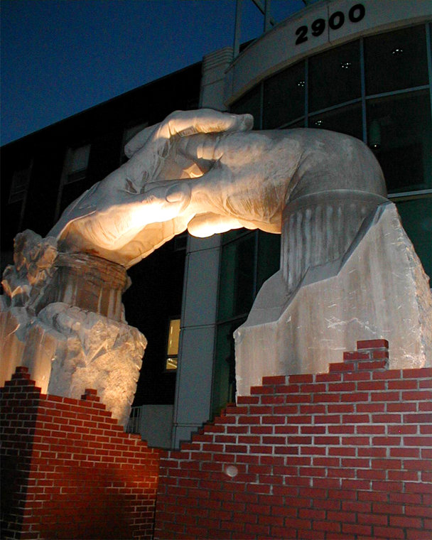 Opportunity Portal Sculpture in Indiana Limestone, nightime view.