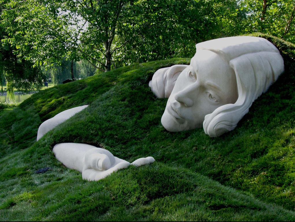 Earthworks and Indiana Limestone sculpture, Awakening Muse Sculpture, by Meg White Sculpture Studio